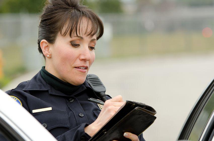 Traffic cop writing a ticket traffic law